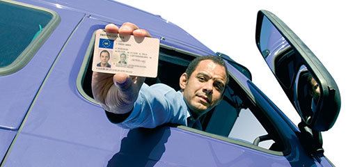 Driver holding out his Driver Qualification Card