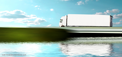Lorry driving beside a lake