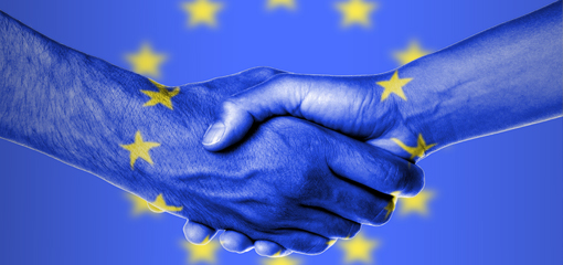 Shaking hands with EU flag behind
