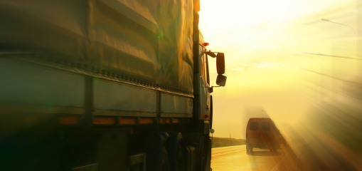 truck and van on blurry road_KICHIGIN_shutterstock_105275723