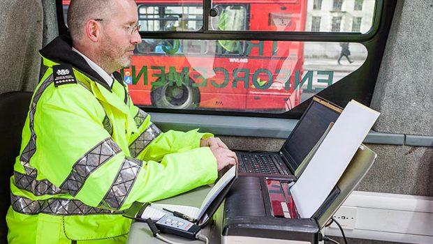A man at computer checking vehicle records