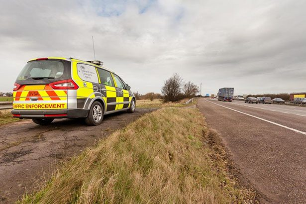 A DVSA enforcement vehicle sits by the roadside