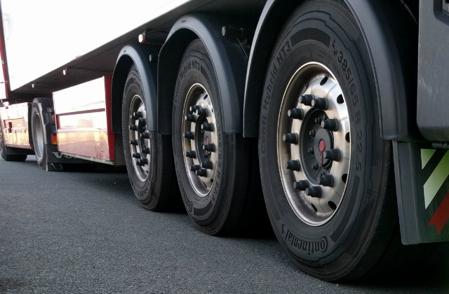 Wheels on a lorry shot from a low angle.