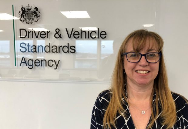 DVSA Director of Encforcement Marian Kitson standing in front of the DVSA Logo. Reads: Driver and Vehicle Standards Agency.
