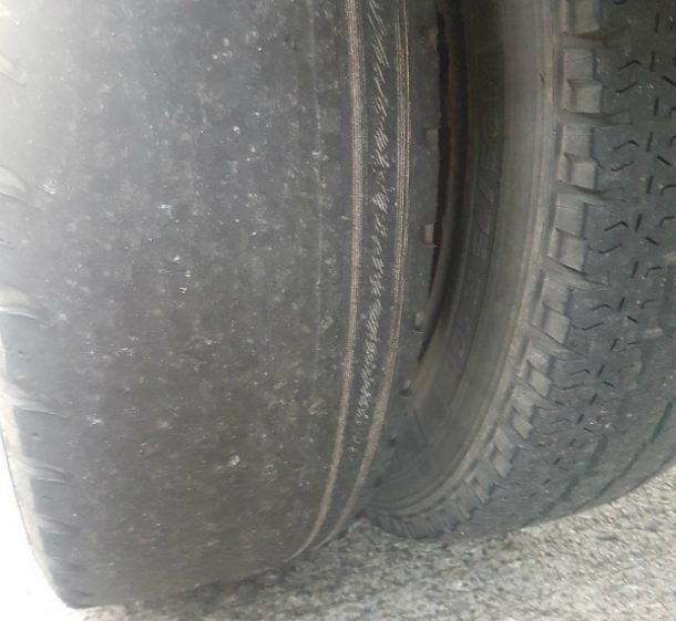 A close up shot of a bald tyre.