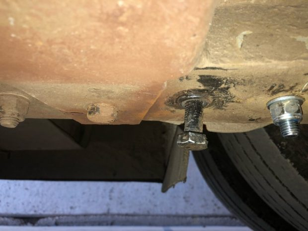 a bolt holding the rear passenger side suspension leaf spring in place being fixed in by glue.
