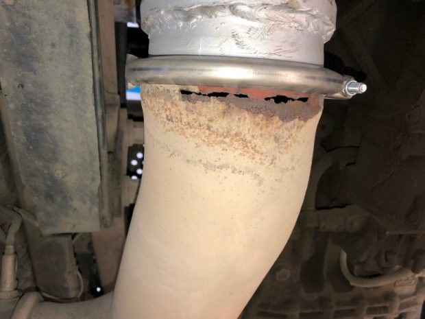a corroded exhaust joint with new section