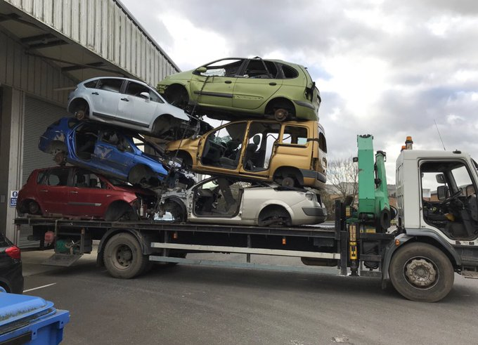 Towering overload lorry with cars due for scrappage