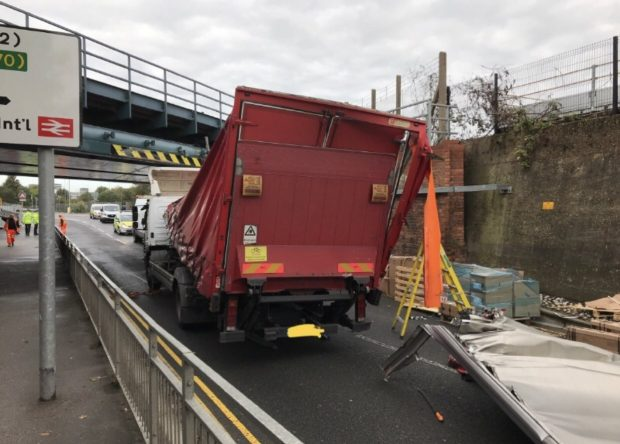 Bridge strike showing a damaged lorry that has hit a bridge