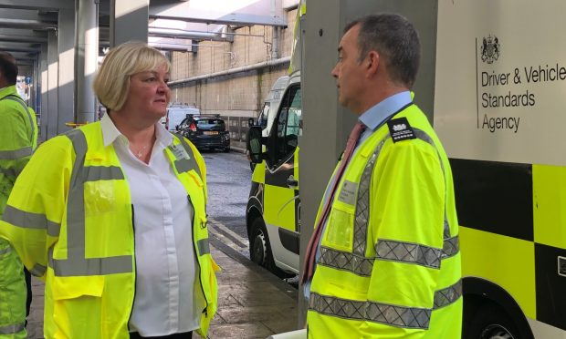 DVSA Enforcement Delivery Manager Della Read talks to a colleague
