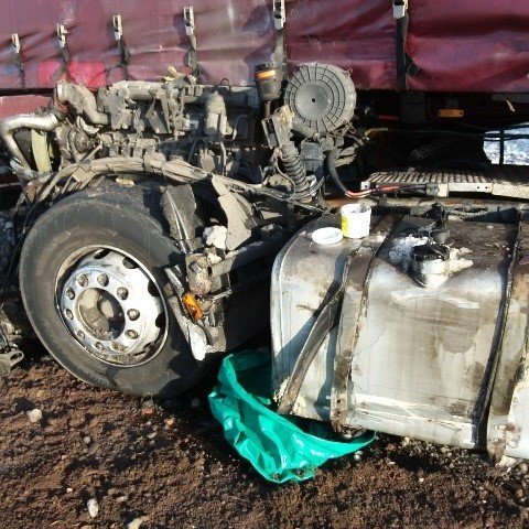 Damaged lorry tank with spillage issue